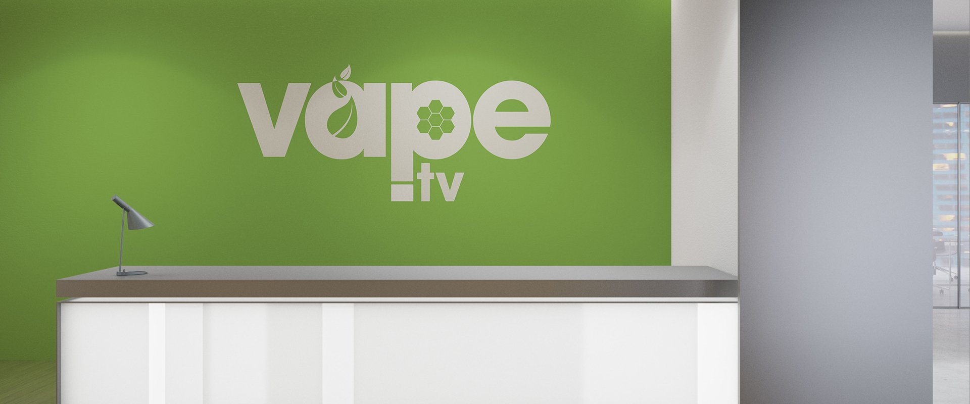 Branded office wall with green background taken from original logo colours.
